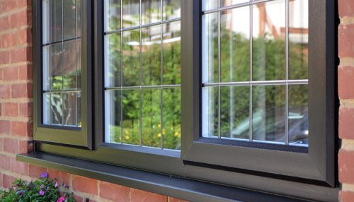 Close up of a black uPVC casement window installation