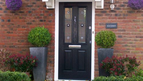 Black composite door and white frame
