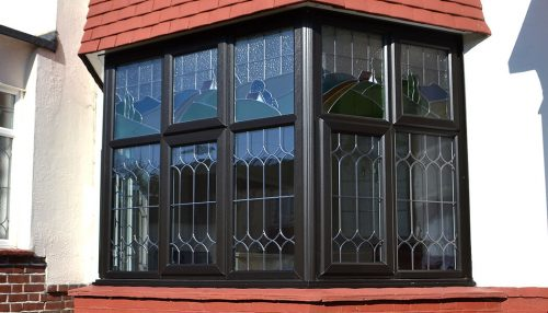 Black uPVC bay window and leaded glass