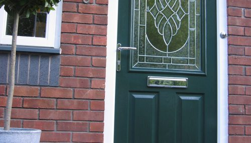 Green composite door with gold hardware