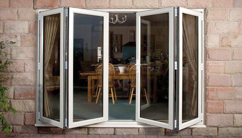 An open white uPVC bifold door