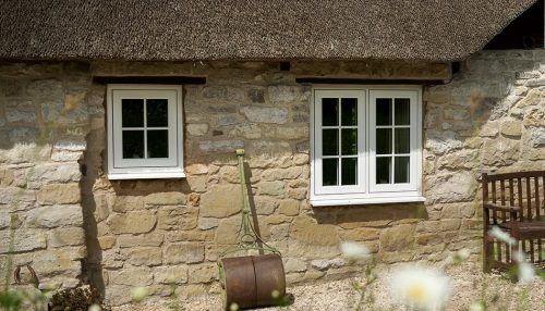 White uPVC heritage flush sash windows