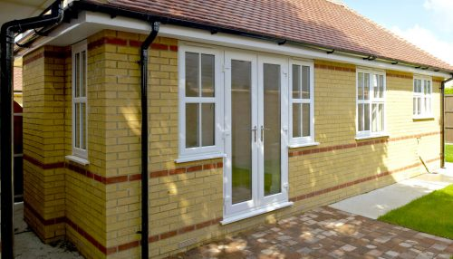 White uPVC french doors and side windows