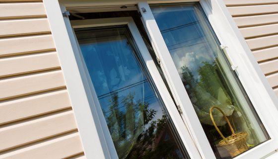 White uPVC tilt and turn window close up