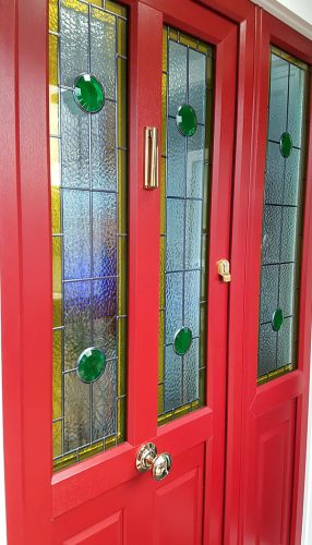 Red entrance door with a side panel