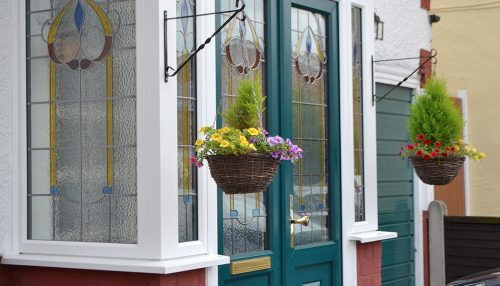 uPVC porch with a green door
