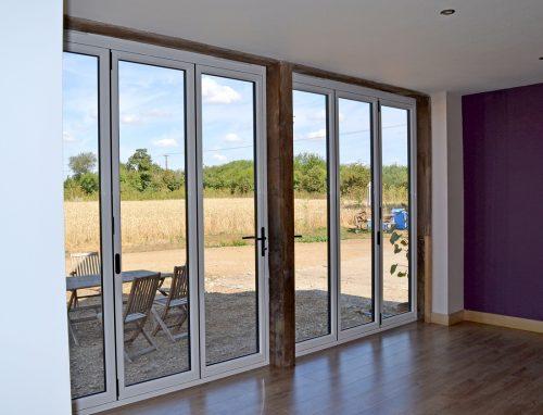 2 x aluminium bifold doors in white