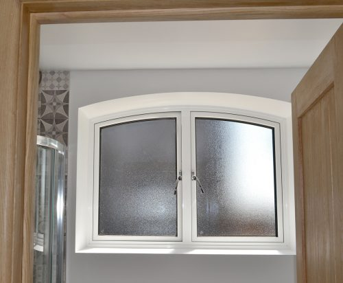 Ali Shaped Bathroom Window