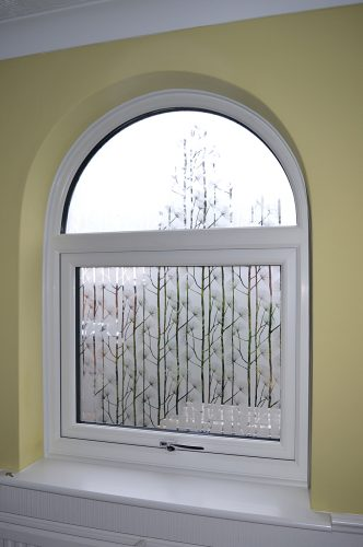 Shaped white upvc window