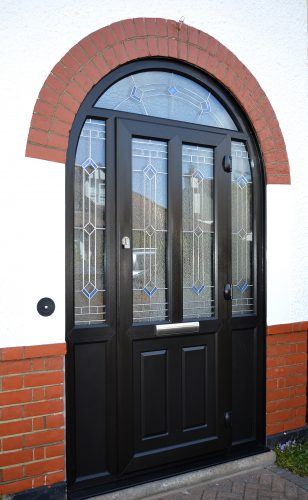 Black door with arched frame